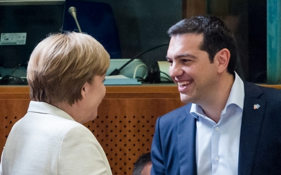 Greek Prime Minister Alexis Tsipras, right, shakes hands with German Chancellor Angela Merkel during a round table meeting at the EU-CELAC summit in Brussels on Wednesday, June 10, 2015. Greece's prime minister was hoping to meet with the leaders of Germany and France in Brussels Wednesday, in the latest effort to break a bailout negotiation deadlock that has revived fears his country could default and drop out of the euro. (AP Photo/Geert Vanden Wijngaert)
