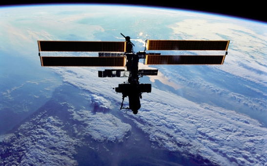 Satellite In Space Orbiting Above Earth...ADCB5B Satellite In Space Orbiting Above Earth