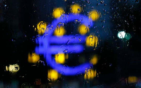 A structure of the Euro currency sign is seen through the window on a rainy evening in Frankfurt...A structure of the Euro currency sign is seen through the window on a rainy evening in Frankfurt July 13, 2012. REUTERS/Alex Domanski (GERMANY - Tags: BUSINESS)